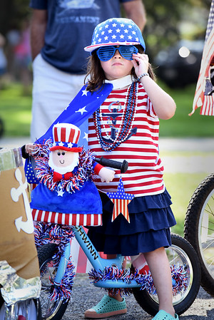 BRYAN EATON/Staff photo. Jennifer Collins, 5, of Byfield dressed in the theme of Uncle Sam is ready for the Bicycle and Carriage Parade at Kids Day in the Park.