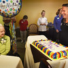 BRYAN EATON/Staff photo. Staffer Jill Ramsdell presents Atria Merrimack Place resident Clara Sillars with her favorite flavored cake: chocolate. Sillars, who was born in Danvers, turned 107 years-old yesterday and was feted by staff and local polititians and quipped with staffers the reason for her longevity was not having children.