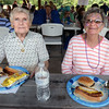 BRYAN EATON/Staff photo. Joan Voorhees, left, and Kathy Burek, residents of the Salisbury Assisted Living Center enjoyed their hamburgers and hot dogs along with earlier face painting.