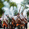 JIM VAIKNORAS/Staff photo. The Fife and Drum Corps of the Acton fire their muskets on High Street during the Yankee Homecoming Parade