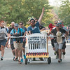 JIM VAIKNORAS/Staff photo The Captain Dad Adventure Club sprints to the finish in the Lions Club Bed Race on Federal Street in Newburyport Thursday night.