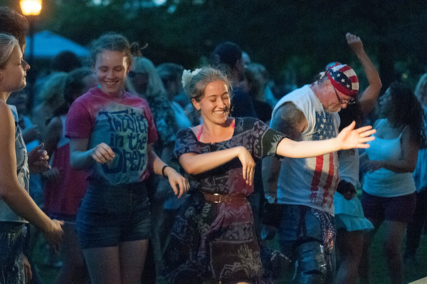 JIM VAIKNORAS/Staff photo Music fans of all ages dance to the sounds of Beatlejuice in Market Landing Park Thursday night. The annual concert fills the Newburyport park with people dancing, and singing along to Beatles music.