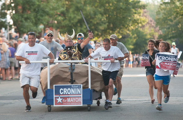 JIM VAIKNORAS/Staff photo Mayoral candidate Bob Cronin's Viking themed bed competes in the Lions Club Bed Race on Federal Street in Newburyport Thursday night.