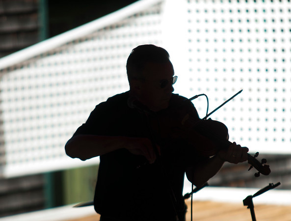 JIM VAIKNORAS/Staff photo Violin player Tom Voder play the National Anthem at the Don Campbell Veteran's Concert at the Maudslay Arts Center in Newburyport Sunday afternoon. The concert makes the 25th anniversary of the venue.