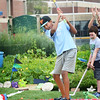 BRYAN EATON/Staff photo. Dmitri Ballou, 15, tees off into the field at Triton High School.