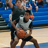 JIM VAIKNORAS/Staff photo Andrew Wannaphong  of Water makes a move on Jesse Maggs of Stay in Yo Lane,  at the Cam Coye 3on3 basketball tournament at Georgetown High School Saturday.