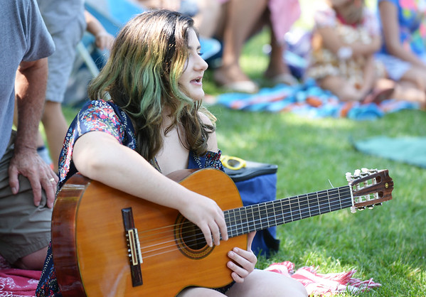 BRYAN EATON/Staff photo. Felicia Berry sings along with another performer on stage at the Kids Talent Showcase as she waits to perform. The 15-year-old from Deerfield, N.H. was visiting her grandparents in Newburyport.