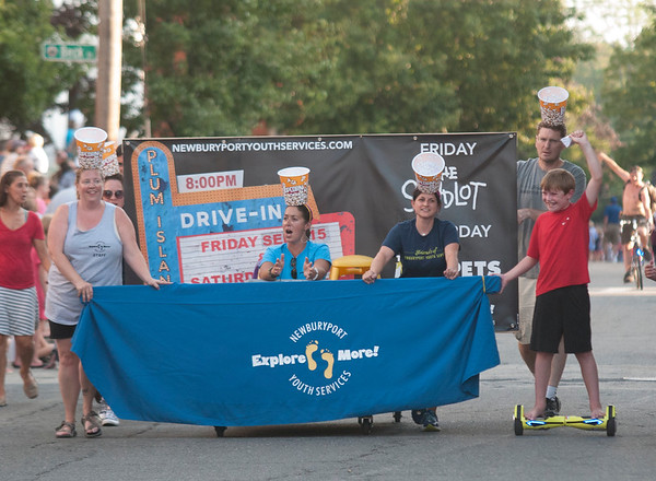 JIM VAIKNORAS/Staff photo Newburyport Youth Services in the Lions Club Bed Race on Federal Street in Newburyport Thursday night.