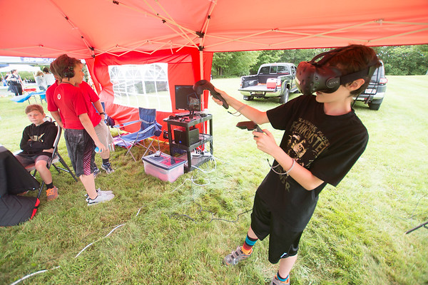 JIM VAIKNORAS/Staff photo Javin Ford checks out the Virtual Reality equipment provided by the Clark School in Rowley  at Family Day at Maudslay Saturday morning.