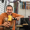 BRYAN EATON/Staff photo. Stephen Moore of Dragon Designs makes belts and other leather goods at the Inn Street Artisan's Revival.