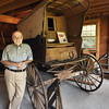 BRYAN EATON/Staff photo. Bartlett Museum board member Paul Moscardini with Fogg's Butcher wagon from Seabrook.