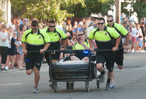JIM VAIKNORAS/Staff photo The Newburyport Police Department were the first bed to run the course in the Lions Club Bed Race on Federal Street in Newburyport Thursday night.