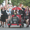 JIM VAIKNORAS/Staff photo The Institution for Savings rides the Hogwarts Express in the Lions Club Bed Race on Federal Street in Newburyport Thursday night.