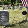 BRYAN EATON/Staff photo. A cleaned gravestone at right contrasts with one yet to be cleaned.