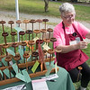 JIM VAIKNORAS/Staff photo Sheila Bosworth, or Journey Wheel in Acton, uses a hand spinner to make yarn at the Fiber Revival at the Spencer Pierce Little Farm in Newbury Saturday.