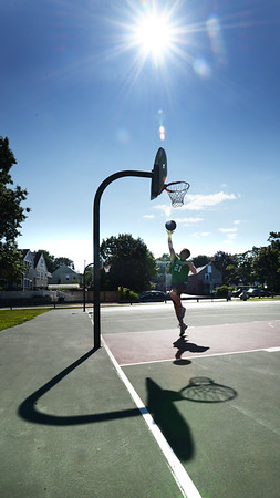 BRYAN EATON/Staff photo. Nico Levasseur of Newburyport practices shots on net at the basketball court at Cashman Park on Thursday afternoon under clear skies. The clear and dry weather continues into the weekend with temperatures in the mid-70's.