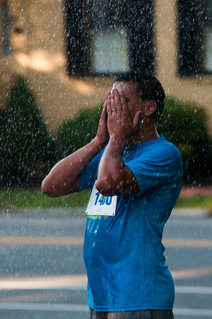 JIM VAIKNORAS/Staff photo Ken Majem cools of after running the Newburyport Lions Club 5k Tuesday night.