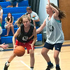 JIM VAIKNORAS/Staff photo Hope Nardon of the Hot Shots guards Kendall Eddy of the Crossovers at the Cam Coye 3on3 basketball tournament at Georgetown High School Saturday.