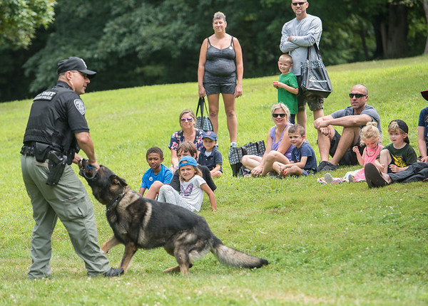 AMANDA SABGA/Staff photo<br /> <br /> People watch a K-9 demonstration by Amesbury Police during Yankee Homecoming's Family Day at Maudslay State Park in Newburyport.<br /> <br /> 8/3/19