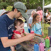 AMANDA SABGA/Staff photo<br /> <br /> Jake Carmody of Rowley, and his daughter Sawyer, 2, create spin art during Yankee Homecoming's Family Day at Maudslay State Park in Newburyport.<br /> <br /> 8/3/19