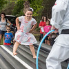 AMANDA SABGA/Staff photo<br /> <br /> Carina Scala, 6, of Plaistow runs karate drills with 5 Dragons Martial Arts Academy during Yankee Homecoming's Family Day at Maudslay State Park in Newburyport.<br /> <br /> 8/3/19