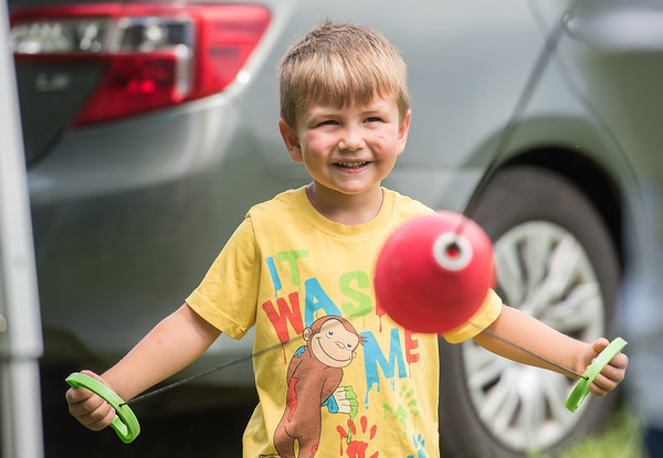 AMANDA SABGA/Staff photo<br /> <br /> Dexter WIlson, 4, of Seabrook plays games during Yankee Homecoming's Family Day at Maudslay State Park in Newburyport.<br /> <br /> 8/3/19