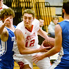 BRYAN EATON/Staff photo. Amesbury plays Georgetown at Triton in the Rowinski Holiday Tournament. Amesbury's Kyle Martin moves through the Georgetown defense.