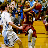 BRYAN EATON/Staff photo. Triton plays Newburyport at Triton in the Rowinski Holiday Tournament. Newburyport's Ronnie Mwai goes for two but comes up short on this drive.