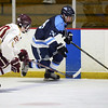 BRYAN EATON/Staff photo. Newburyport High School hosts Franklin High School at the Graf Rink. Newburyport forward Jacob Grossi-Hogg moves in on a Franklin player.