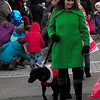 JIM VAIKNORAS/Staff photo Dee Dee Kearney marches with River in  Amesbury's annual Santa Parade.