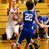 BRYAN EATON/Staff photo. Amesbury plays Georgetown at Triton in the Rowinski Holiday Tournament. Amesbury's John Sydlowski looks for an open teammate.