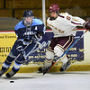 BRYAN EATON/Staff photo. Newburyport High School hosts Franklin High School at the Graf Rink. Newburyport's Justin Knight put pressure on a Franklin player.