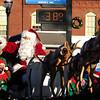 JIM VAIKNORAS/Staff photo Santa arrives in Merrimac Square during the town's Annual Santa Parade.