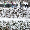 BRYAN EATON/Staff photo. Girls from the Newburyport High School winter track team take a run along Greenleaf Street above the snow-covered Bartlet Mall Monday afternoon. More snow or rain could fall on Wednesday, though nothing major is expected.