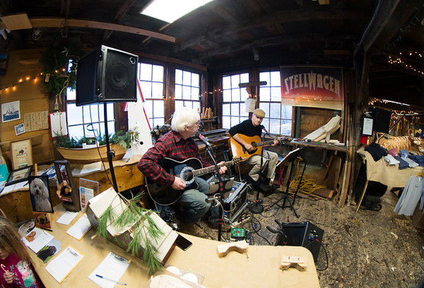 JIM VAIKNORAS/Staff photo Rob Brun and Jim Grenier of Stellwagen perform at Lowell's Boat Shop's open house Sunday afternoon in Amesbury.Along with the music, the event included games and crafts for kids, rum for the adults, food, a silent auction, and lots to see for everyone.
