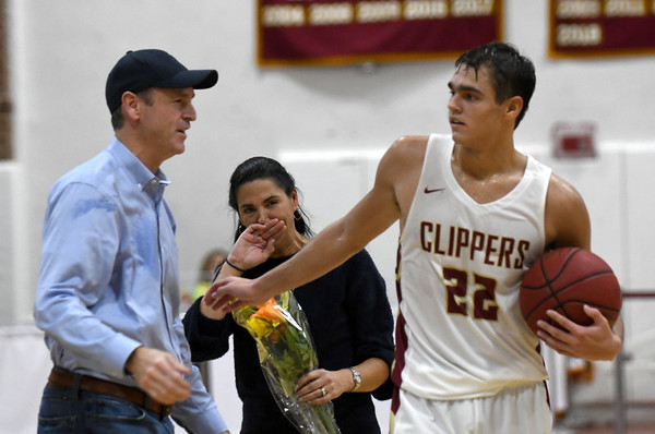 JIM VAIKNORAS/Staff photo Newburyport's Casey McLaren greets his parents Amy and Craig McLaren after scoring his 100th career point during the Clippers game against New Mission at Newburyport Friday night.
