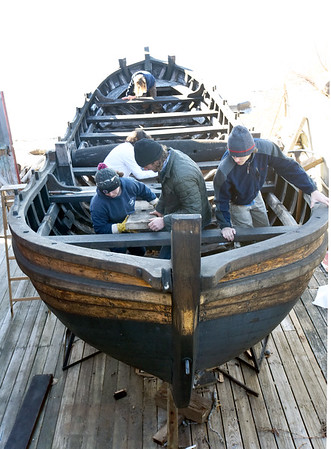 BRYAN EATON/Staff photo. Graham McKay and his team of high school aprentices at Lowell's Boat Shop are restoring a replica of a shallop which was used on the Mayflower to bring crew and passengers to shore from the mother ship.