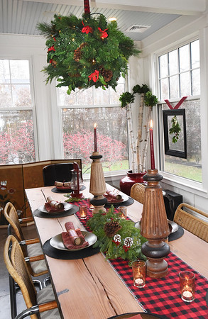 BRYAN EATON/Staff photo. The sun room at the Poston-Gay residence provides for a bright table setting.