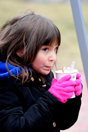 JIM VAIKNORAS/Staff photo Zoey Defranco,5, enjoys a hot coco courtesy of the All Saints Anglican Church during Amesbury's Winterfest Sunday afternoon.