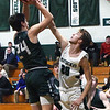 BRYAN EATON/Staff photo. Pentucket Sam Stys covers Manchester-Essex sophomore Frank Wood.