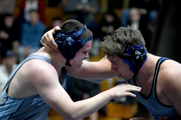 JIM VAIKNORAS/Staff photo Triton's Barry Nagle wrestles Nick Frongello in the 285lb weight class, at Triton Wednesday.