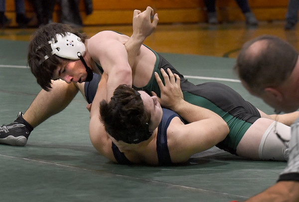 BRYAN EATON/Staff photo. Pentucket's Chris Legacy pins Essex Tech's Manny Alves in the 152 class.