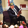 "BRYAN EATON/Staff photo. Jim Poulin plays the conductor as he reads ""The Polar Express"" sponsored by Family Connections and the Salisbury Public Library where the event was held on Tuesday night. There was surprise visit by Santa Claus for the children who arrived with a police and fire department escort."