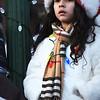 BRYAN EATON/Staff photo. Wearing a Santa Claus hat and Christmas lights around her neck, Carmilla Maldondo, 6, waits to see St. Nick in the Amesbury Santa Parade.