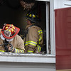 BRYAN EATON/Staff photo. Newburyport firefighters check out the remains of a fire on a window sill at the Old South Church apparently caused by a candle in part of a Christmas decoration.