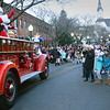 BRYAN EATON/Staff photo. Santa Claus waves to the crowd before disembarking the fire engine to light the Christmas Tree in Amesbury's Market Square.