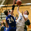BRYAN EATON/Staff photo. Georgetown's Brendan Willis tries to block Triton's Jesse Wilkinson.