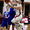 JIM VAIKNORAS/Staff photo Newburyport's Ryan Archie  drives past Georgtown's Brendan Willis  at the Rowinski Holiday Tournament championship game at Newburyport High School Friday night.