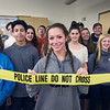 BRYAN EATON/Staff photo. Actual police tape was used in Trisha Cignetti's Forensic Class at Amesbury High School while an investigation was underway. Former student and Amesbury Police officer John Lannon, who is the school resource officer, helped student solve the case.