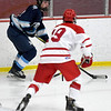 JIM VAIKNORAS/Staff photo Triton's Jack Niska controls the puck against Melrose at Kasabuski Rink in Saugus.